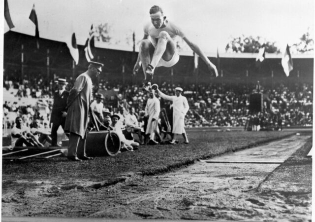 FILE - In this 1912 file photo, Albert Gutterson, of the United States, competes in the long jump at the 1912 Olympic Games in Stockholm. Gutterson went on to win the gold. (Pressens Bild/TT via AP)
