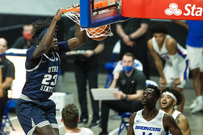 Utah State center Neemias Queta (23) dunks the ball during the first half of an NCAA college basketball game against Boise State Wednesday, Feb. 17, 2021 at ExtraMile Arena in Boise, Idaho. (Darin Oswald/Idaho Statesman via AP)