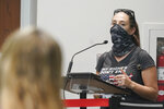 Jenna Hague speaks at the Broward School Board's emergency meeting, Wednesday, July 28, 2021, in Fort Lauderdale, Fla. The board listened to parents' concerns and will make a decision regarding the use of masks for K-12 students in the upcoming school year. (AP Photo/Marta Lavandier)