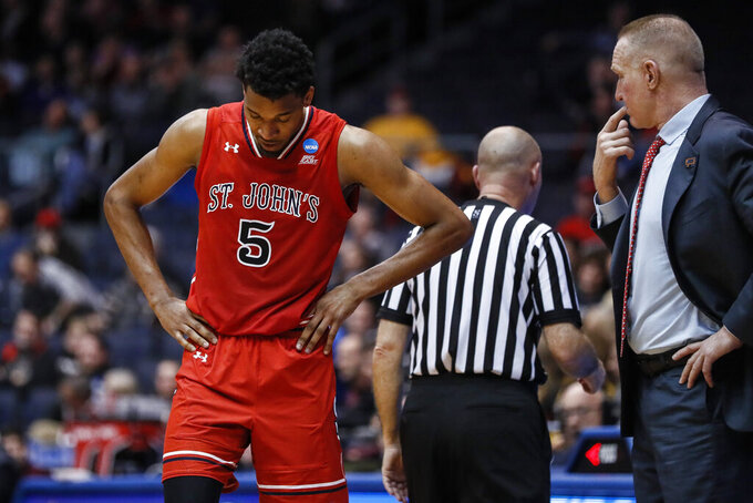 St. John's Justin Simon (5) reacts alongside coach Chris Mullin, right, during the second half of the team's First Four game against Arizona State in the NCAA men's college basketball tournament Wednesday, March 20, 2019, in Dayton, Ohio. (AP Photo/John Minchillo)