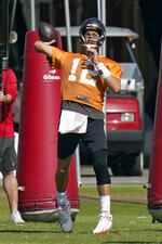 Tampa Bay Buccaneers quarterback Tom Brady (12) throws a pass during an NFL football practice Thursday, Nov. 5, 2020, in Tampa, Fla. (AP Photo/Chris O'Meara)