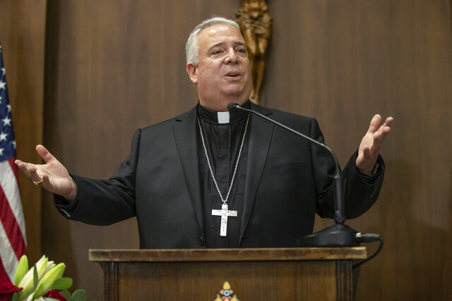 Philadelphia Archbishop-elect Nelson J. Perez addresses those assembled at the Archdiocese's offices after his introduction by Archbishop Charles J. Chaput, as the 14th Bishop and 10th Archbishop of Philadelphia, on Thursday, January 23, 2020.   (Michael Bryant/The Philadelphia Inquirer via AP )