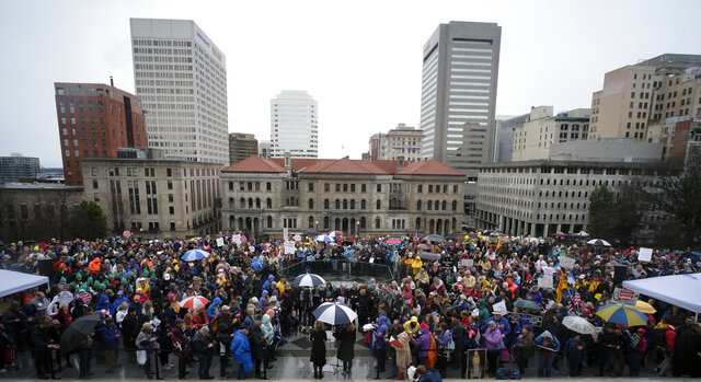 A crowd gathers for the Virginia March for Life rally outside the Virginia State Capitol in Richmond, Va., Thursday, Feb. 13, 2020. (Bob Brown/Richmond Times-Dispatch via AP)
