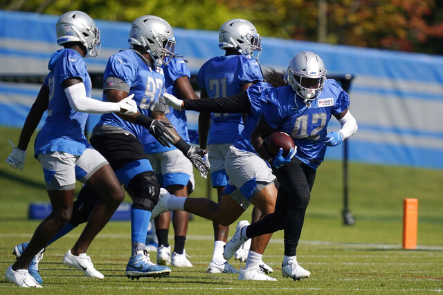 Detroit Lions safety Jalen Elliott (42) runs through a drill at the Lions NFL football camp practice, Saturday, Aug. 22, 2020, in Allen Park, Mich. (AP Photo/Carlos Osorio)