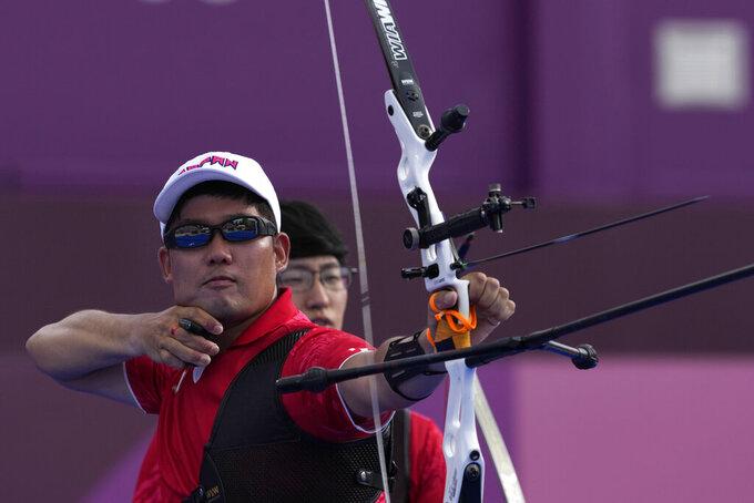 Japan's Takaharu Furukawa shoots an arrow during the men's team bronze medal match against the Netherlands at the 2020 Summer Olympics, Monday, July 26, 2021, in Tokyo, Japan. (AP Photo/Alessandra Tarantino)