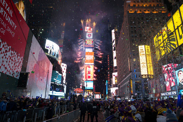 "FILE - In this Jan. 1. 2017 file photo, confetti falls as people celebrate the new year in New York's Times Square. This year's New Year's Eve celebration in Times Square will spotlight efforts to combat climate change when high school science teachers and students press the button that begins the famous 60-second ball drop and countdown to next year. ""On New Year's Eve, we look back and reflect on the dominant themes of the past year, and seek hope and inspiration as we look forward,"