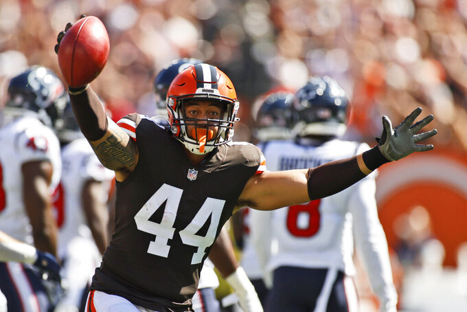 Cleveland Browns linebacker Sione Takitaki celebrates a fumble recovery on the punt during the first half of an NFL football game against the Houston Texans, Sunday, Sept. 19, 2021, in Cleveland. (AP Photo/Ron Schwane)