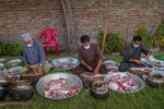 Kashmiri Wazas, or chefs, chop mutton before cooking for a wedding feast Wazwan on outskirts of Srinagar, Indian controlled Kashmir, Tuesday, Sept. 16, 2020. The coronavirus pandemic has changed the way people celebrate weddings in Kashmir. The traditional week-long feasting , elaborate rituals and huge gatherings have given way to muted ceremonies with a limited number of close relatives attending. With restrictions in place and many weddings cancelled, the traditional wedding chefs have little or no work. The virus has drastically impacted the life and businesses in the region. (AP Photo/ Dar Yasin)