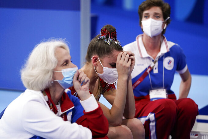Dina Averina, of the Russian Olympic Committee, reacts after seeing her final score in the individual all-around rhythmic gymnastics final at the 2020 Summer Olympics, Saturday, Aug. 7, 2021, in Tokyo, Japan. Averina won the silver medal in the event. (AP Photo/Ashley Landis)