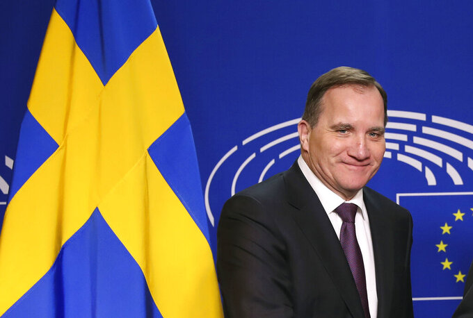 """FILE - In this file photo dated Wednesday, April 3, 2019, Sweden's Prime Minister Stefan Lofven, before a meeting at the European Parliament in Brussels.  Sweden's lawmakers have held a memorial service for the more than 5,000 people who died of COVID-19, Wednesday June 17, 2020, and the Riksdag parliament stood to observe a minute of silence, while Prime Minister Stefan Lofven said Tuesday he thought it was """"a little strange"""" that fellow Nordic nations haven't reopened their borders to Swedes. (AP Photo/Francisco Seco, FILE)"""