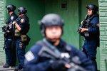 Law enforcement guards near the scene following a shooting, Tuesday, Dec. 10, 2019, in Jersey City, N.J.  AP Photo/Eduardo Munoz Alvarez)