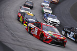 Kyle Busch (18) leads the fields through a turn during a NASCAR Cup Series auto race, Sunday, April 7, 2019, in Bristol, Tenn. (AP Photo/Wade Payne)