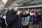 An opposition activist Nikolai Statkevich, wearing a face mask to protect against coronavirus, gestures as he speaks to people gathered to sign up and support potential presidential candidates in the upcoming presidential elections in Minsk, Belarus, Sunday, May 24, 2020. The presidential campaign is underway in Belarus despite the coronavirus outbreak after the parliament and government refused to postpone the election scheduled for August 9. (AP Photo/Sergei Grits)