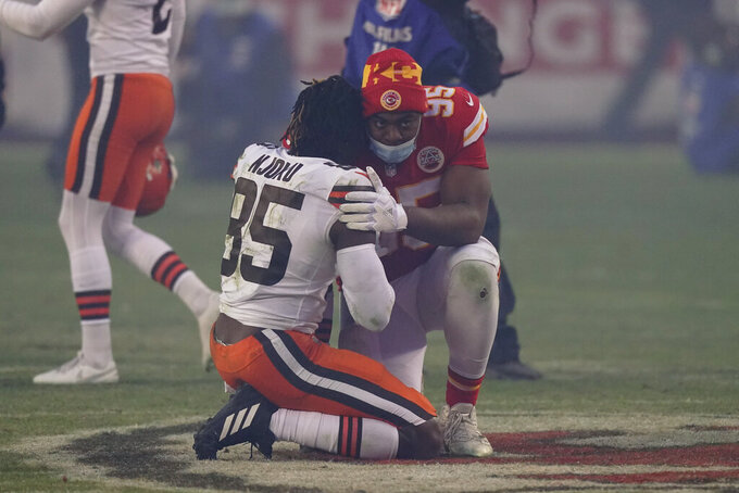 Cleveland Browns tight end David Njoku, left, is consoled by Kansas City Chiefs defensive tackle Chris Jones, right, after an NFL divisional round football game, Sunday, Jan. 17, 2021, in Kansas City. The Chiefs won 22-17. (AP Photo/Charlie Riedel)