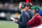 Arizona Cardinals head coach Kliff Kingsbury watches for the sideline in the first half of an NFL football game against the New Orleans Saints in New Orleans, Sunday, Oct. 27, 2019. (AP Photo/Butch Dill)