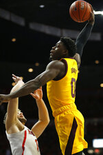 Arizona State guard Luguentz Dort (0) dunks over Arizona forward Ryan Luther in the first half during an NCAA college basketball game, Saturday, March 9, 2019, in Tucson, Ariz. (AP Photo/Rick Scuteri)
