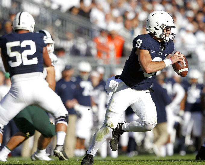 Penn State quarterback Trace McSorley (9) rolls out of the pocket looking to pass against Michigan State during the first half of an NCAA college football game in State College, Pa., Saturday, Oct. 13, 2018. (AP Photo/Chris Knight)