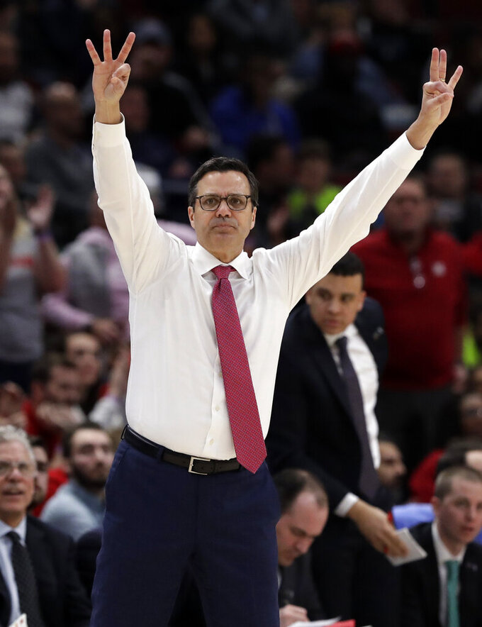 Nebraska head coach Tim Miles celebrates after guard James Palmer Jr., made a 3-point basket during the second half of an NCAA college basketball game in the first round of the Big Ten Conference tournament against Rutgers in Chicago, Wednesday, March 13, 2019. Nebraska won 68-61. (AP Photo/Nam Y. Huh)