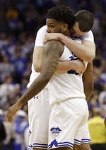 Seton Hall forward Sandro Mamukelashvili, left, embraces  guard Myles Powell during the second half of an NCAA college basketball game, Saturday, March 9, 2019, in Newark, N.J. Powell was the high scorer with 20 points as Seton Hall defeated Villanova 79-75. (AP Photo/Kathy Willens)