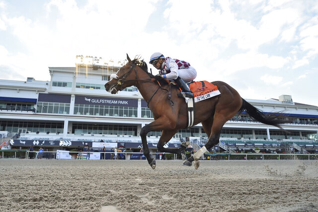 In this image provided by Gulfstream Park, Tiz the Law, riddren by Manuel Franco, wins the Florida Derby horse race at Gulfstream Park, Saturday, March 28, 2020, in Hallandale Beach, Fla. (Lauren King/Coglianese Photos, Gulfstream Park via AP)