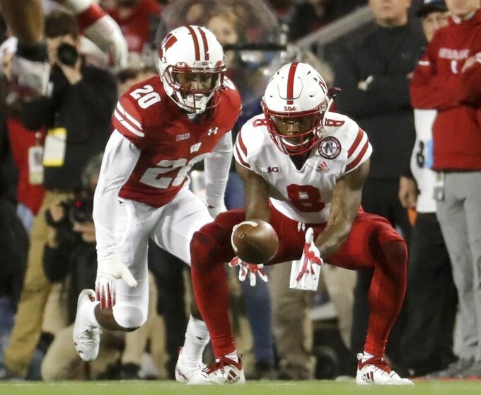FILE - In this Oct. 6, 2018, file photo, Nebraska's Stanley Morgan Jr. catches a pass in front of Wisconsin's Faion Hicks during the first half of an NCAA college football game in Madison, Wis. Wisconsin returns every cornerback and still has no seniors at the position. Coach Paul Chryst said he expects sophomore Hicks to take a huge leap after 35 tackles and an interception in 12 games (11 starts) last season. (AP Photo/Morry Gash, File)