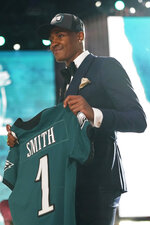 Alabama wide receiver DeVonta Smith holds a team jersey after he was chosen by the Philadelphia Eagles with the 10th pick in the first round of the NFL football draft Thursday April 29, 2021, in Cleveland. (AP Photo/Tony Dejak)