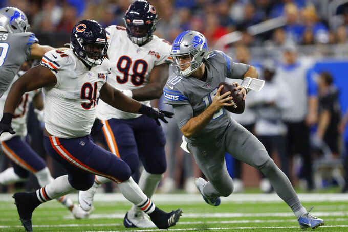 Detroit Lions quarterback David Blough (10) is chased by Chicago Bears nose tackle Eddie Goldman (91) during the second half of an NFL football game, Thursday, Nov. 28, 2019, in Detroit. (AP Photo/Paul Sancya)
