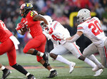 Maryland running back Anthony McFarland (5) runs the ball past Ohio State linebacker Pete Werner (20) during the second half of an NCAA football game, Saturday, Nov. 17, 2018, in College Park, Md. Ohio State won 52-51 in overtime. (AP Photo/Nick Wass)
