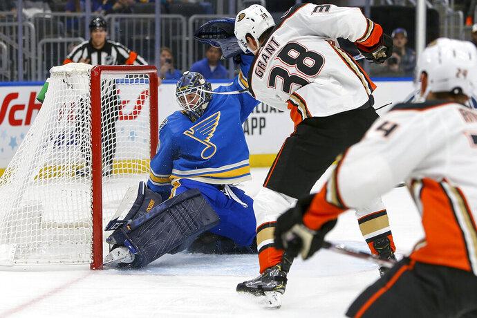 Anaheim Ducks' Derek Grant (38) scores a goal against St. Louis Blues goaltender Jordan Binnington during the first period of an NHL hockey game Saturday, Nov. 16, 2019, in St. Louis. (AP Photo/Scott Kane)