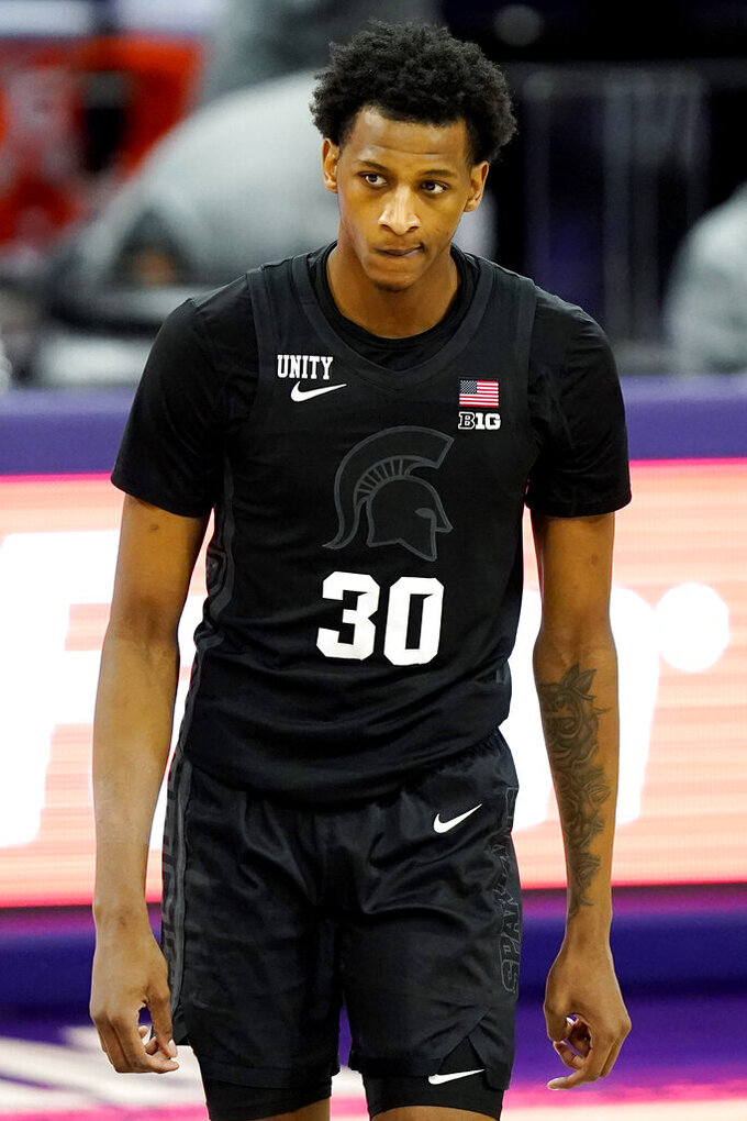 Michigan State forward Marcus Bingham Jr. reacts as he walks on the court during the second half of an NCAA college basketball game against Northwestern in Evanston, Ill., Sunday, Dec. 20, 2020. Northwestern won 79-65. (AP Photo/Nam Y. Huh)