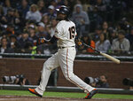 San Francisco Giants' Alen Hanson watches his RBI triple off Pittsburgh Pirates starting pitcher Ivan Nova during the fifth inning of a baseball game Thursday, Aug. 9, 2018, in San Francisco. (AP Photo/Eric Risberg)