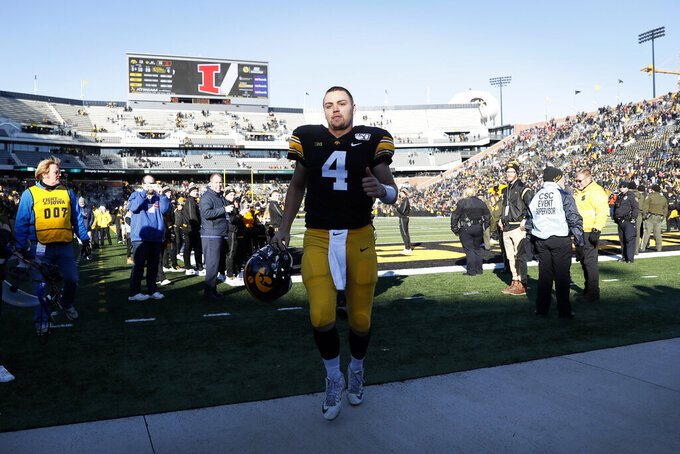 Iowa quarterback Nate Stanley runs off the field after an NCAA college football game against Illinois, Saturday, Nov. 23, 2019, in Iowa City, Iowa. Iowa won 19-10. (AP Photo/Charlie Neibergall)