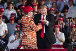 President Donald Trump, right, brings Blake Marnell on stage during a campaign rally in Montoursville, Pa., Monday, May 20, 2019. (AP Photo/Matt Rourke)
