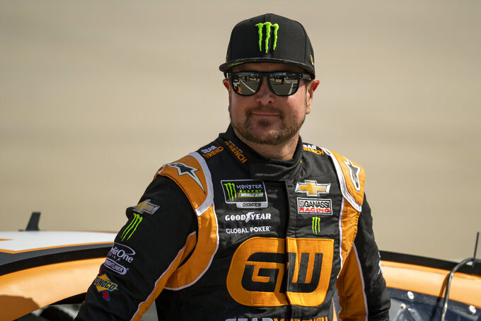 Driver Kurt Busch waits by his car before qualifying rounds at a NASCAR Xfinity Series Playoff Race, Saturday, Oct. 5, 2019, in Dover, Del. (AP Photo/Brien Aho)