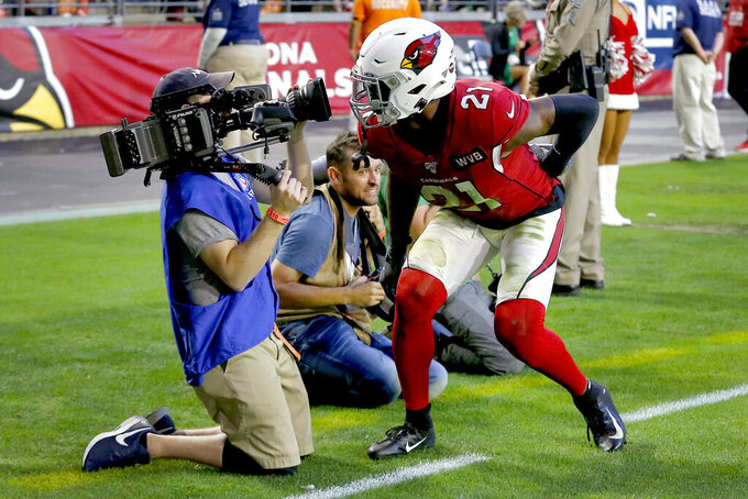 Arizona Cardinals cornerback Patrick Peterson (21) looks into an NFL Films camera after a defensive stop against the Cleveland Browns during the second half of an NFL football game, Sunday, Dec. 15, 2019, in Glendale, Ariz. The Cardinals won 38-24. (AP Photo/Rick Scuteri)