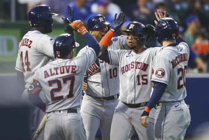 Houston Astros' Martin Maldonado (15) celebrates with Yuli Gurriel (10), Chas McCormick (20), Yordan Alvarez (44), and Jose Altuve (27) after hitting a grand slam during the sixth inning of the team's baseball game against the Toronto Blue Jays in Buffalo, N.Y., Friday, June 4, 2021. (AP Photo/Joshua Bessex)