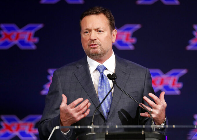 FILE - Bob Stoops makes comments after being introduced as the new head coach and general manager of the XFL Dallas football team during a news conference in Arlington, Texas, in this Thursday, Feb. 7, 2019, file photo. Former Oklahoma coach Bob Stoops will replace Urban Meyer on Fox's Saturday college football pregame show, the network announced Monday, March 9, 2021. (AP Photo/Tony Gutierrez, File)
