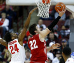 Wisconsin forward Ethan Happ, right, goes up for a shot against Ohio State forward Andre Wesson during the second half of an NCAA college basketball game in Columbus, Ohio, Sunday, March 10, 2019. Wisconsin won 73-67 in overtime. (AP Photo/Paul Vernon)