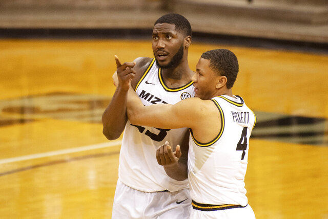 Missouri's Jeremiah Tilmon, left, is embraced by teammate Javon Pickett, right, after they defeated Bradley in an NCAA college basketball game Tuesday, Dec. 22, 2020, in Columbia, Mo. (AP Photo/L.G. Patterson)