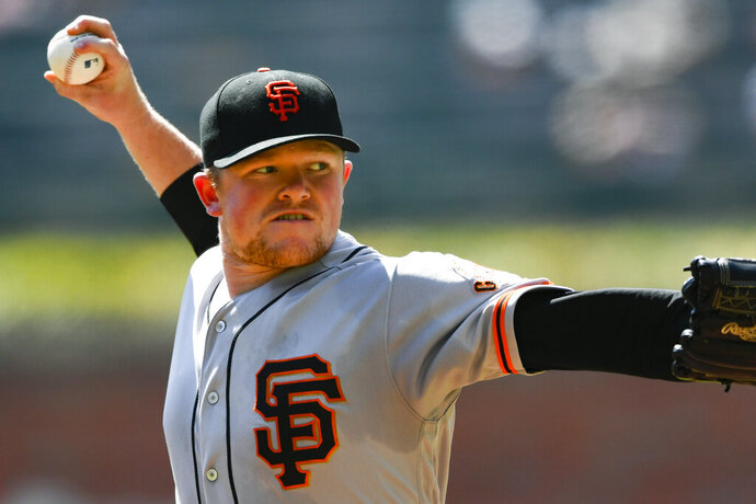 San Francisco Giants' Logan Webb pitches against the Atlanta Braves during the first inning of a baseball game Sunday, Sept. 22, 2019, in Atlanta. (AP Photo/John Amis)