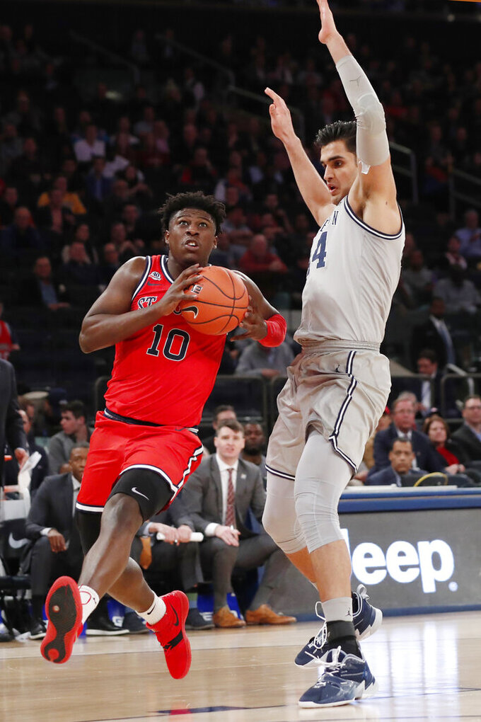 St. John's forward Marcellus Earlington (10) drives around Georgetown center Omer Yurtseven (44) during the second half of an NCAA college basketball game in the first round of the Big East men's tournament Wednesday, March 11, 2020, in New York. (AP Photo/Kathy Willens)