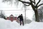 Judy Porter shovels her sidewalk on Tuesday, Feb. 12, 2019, in Appleton, Wis.  The latest snow storm to move through the state dropped several inches of snow overnight. (Wm. Glasheen/The Post-Crescent via AP)