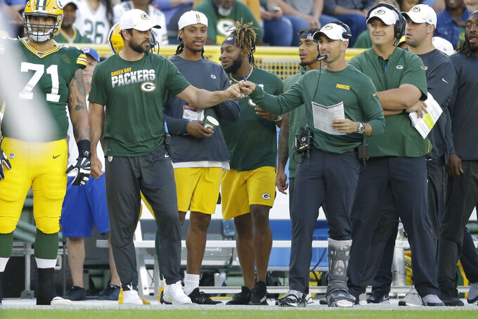 Rodgers held out of preseason game with back tightness