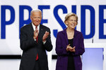 FILE - In this Oct. 15, 2019, file photo, Democratic presidential candidate former Vice President Joe Biden, left, and then-candidate Sen. Elizabeth Warren, D-Mass., arrive to participate in a Democratic presidential primary debate at Otterbein University in Westerville, Ohio. Biden's search for a running mate is entering a second round of vetting for a dwindling list of potential vice presidential nominees, with several black women in strong contention. (AP Photo/John Minchillo, File)