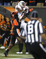 Washington State's Tay Martin (1) goes over Oregon State's Kaleb Hayes (14) for a touchdown catch during the first half of an NCAA college football in Corvallis, Ore., Saturday, Oct. 6, 2018. (AP Photo/Timothy J. Gonzalez)