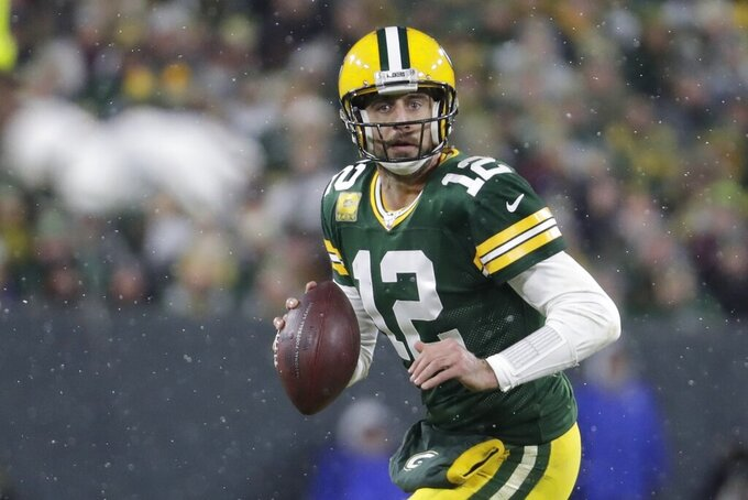 Green Bay Packers' Aaron Rodgers looks to pass during the second half of an NFL football game against the Carolina Panthers Sunday, Nov. 10, 2019, in Green Bay, Wis. (AP Photo/Morry Gash)