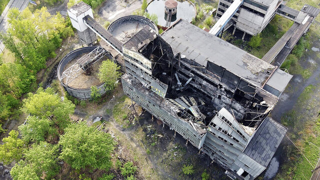 In this photo taken by a drone, parts of a disused building belonging to a mining-related company collapsed in the southern town of Myslowice, in Poland, on Friday, May 15, 2020, sending rescuers with drones and sniffer dogs to search for any people that might have been inside, though no trace of anyone was found through late Friday. The building is to be taken apart. (AP Photo/Adrian Panasiuk)