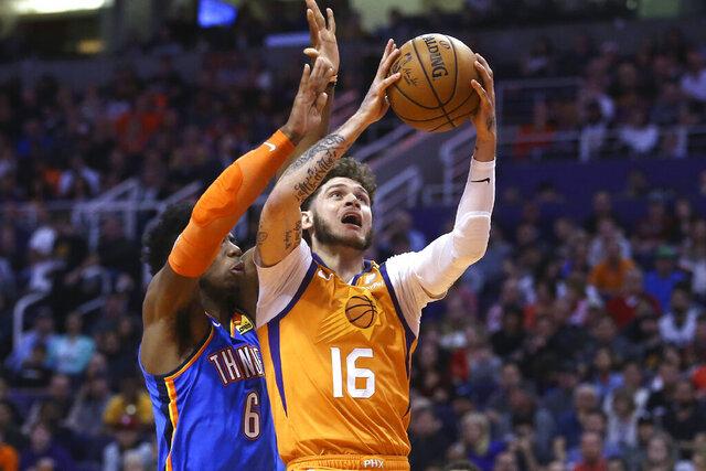 Phoenix Suns guard Tyler Johnson (16) drives past Oklahoma City Thunder guard Hamidou Diallo (6) during the second half of an NBA basketball game Friday, Jan. 31, 2020, in Phoenix. The Thunder won 111-107. (AP Photo/Ross D. Franklin)