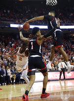 Texas guard Matt Coleman III (2) has his shot blocked by Texas Tech forward TJ Holyfield (22) during the second half of an NCAA college basketball game, Saturday, Feb. 8, 2020, in Austin, Texas. Texas Tech won 62-57. (AP Photo/Eric Gay)