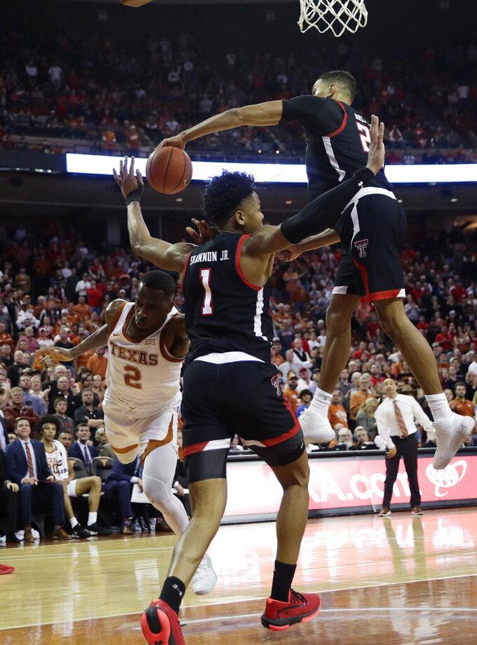 Texas guard Matt Coleman III (2) has his shot blocked by Texas Tech forward TJ Holyfield (22) during the second half of an NCAA college basketball game, Saturday, Feb. 8, 2020, in Austin, Texas. Texas Tech won 62-57. (AP Photo/Eric Gay)